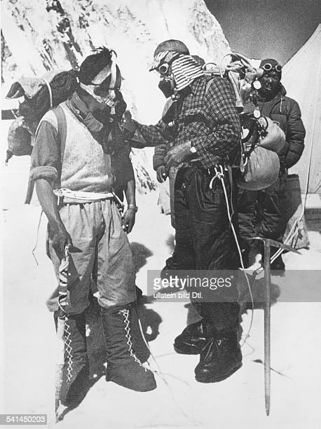 SIR EDMUND HILLARY New Zealand mountaineer and explorer Hillary with the Sherpa guide Tenzing Norgay during their successful Mount Everest expedition...