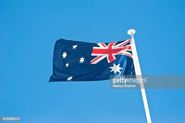 New Zealand national flag against a blue sky