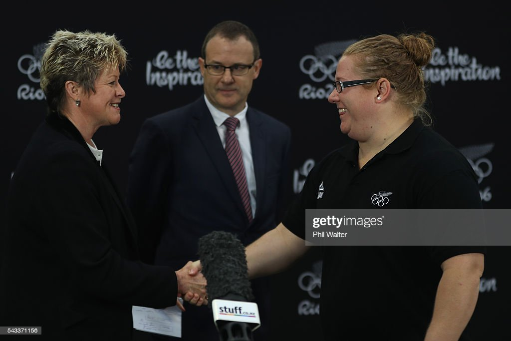 New Zealand Olympic Committee CEO Kereyn Smith (L) congrtulates Tracey Lambrechs (R) during the New Zealand Olympic Weightlifting Team Selection announcement at Functional Strength HQ on June 28, 2016 in Auckland, New Zealand.