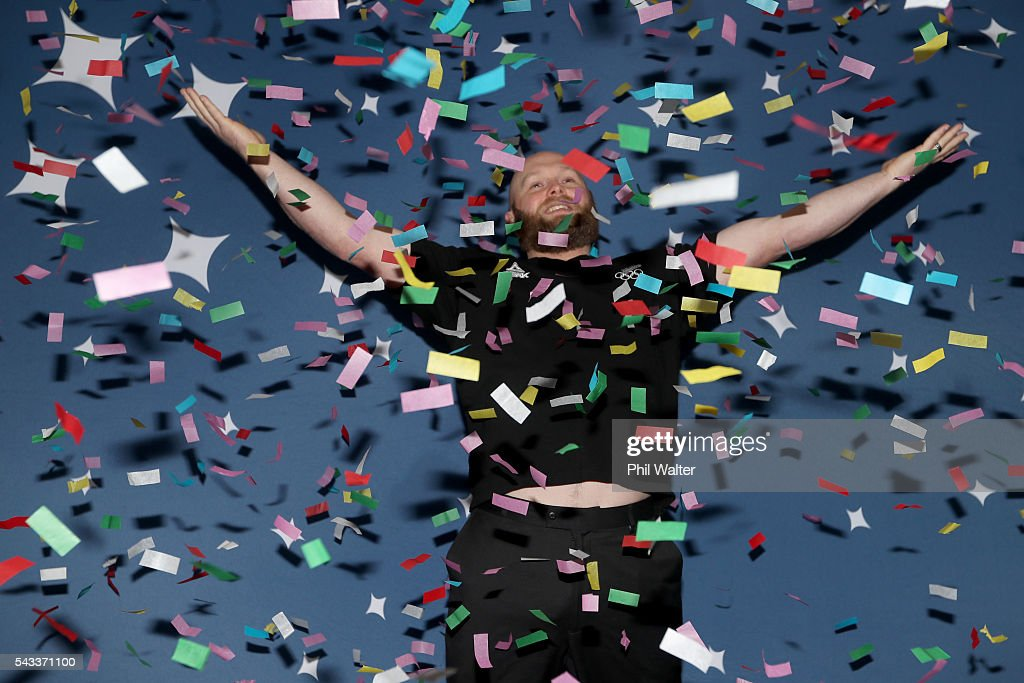 New Zealand Olympic Weightlifter Richie Patterson jumps under a confetti canon after the New Zealand Olympic Weightlifting Team Selection announcement at Functional Strength HQ on June 28, 2016 in Auckland, New Zealand.