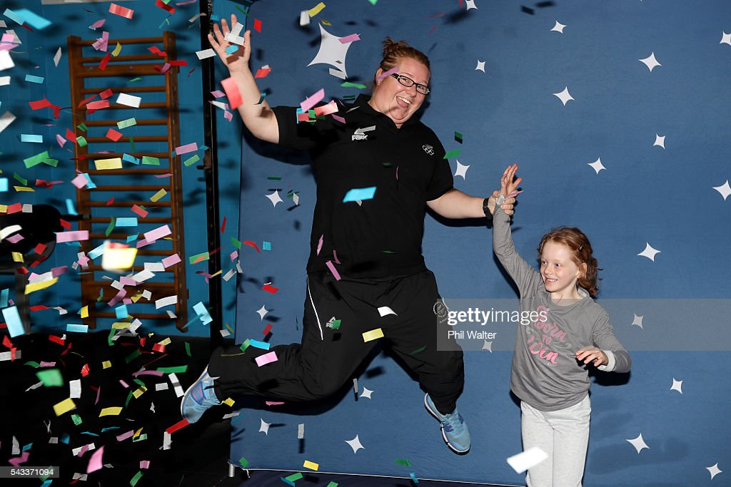 New Zealand Olympic Weightlifter Tracey Lambrechs jumps under a confetti canon with her niece Michelle Catterall after the New Zealand Olympic Weightlifting Team Selection announcement at Functional Strength HQ on June 28, 2016 in Auckland, New Zealand.