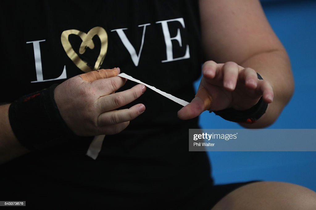 New Zealand Olympic Weightlifter Tracey Lambrechs prepares to lift weights following the New Zealand Olympic Weightlifting Team Selection announcement at Functional Strength HQ on June 28, 2016 in Auckland, New Zealand.