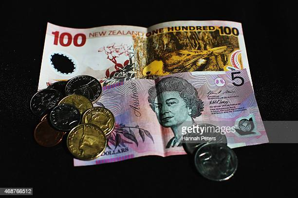 New Zealand onehundred dollar banknote an Australian five dollar banknote and New Zealand coins are arranged for a photo on April 7 2015 in Auckland...