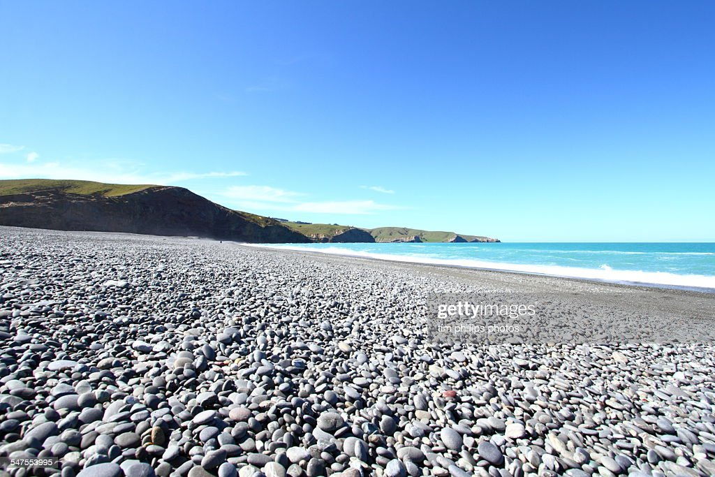New zealand pebble beach stock photo getty images for Pebble beach collection