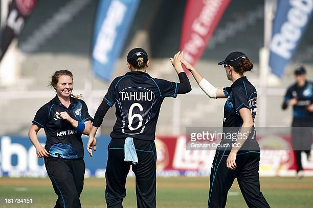 New Zealand players celebrate a wicket during the 3rd/4th Place PlayOff game between England and New Zealand at the Women's World Cup India 2013 at...