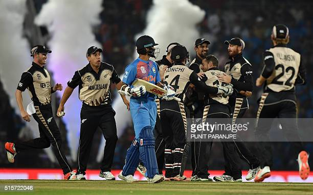 New Zealand players celebrate after the wicket of India's batsman Shikhar Dhawan during the World T20 cricket tournament match between India and New...