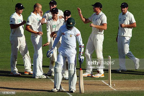 New Zealand players celebrate the wicket of Shingirai Masakadza of Zimbabwe during day three of the test match between New Zealand and Zimbabwe at...