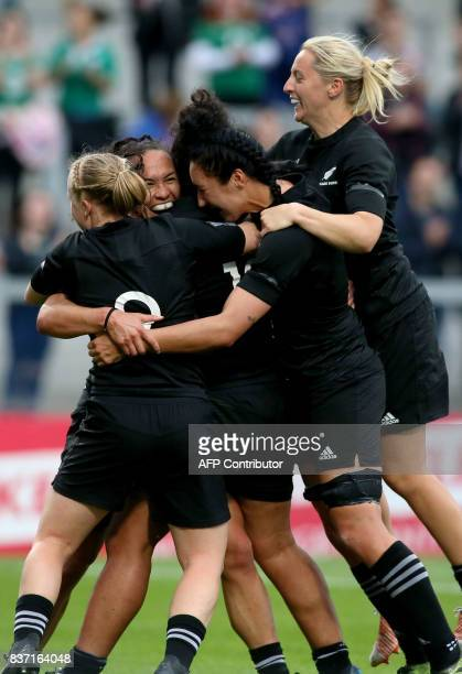 New Zealand players celebrate their second try scored by New Zealand's wing Portia Woodman during the Women's Rugby World Cup 2017 semifinal match...