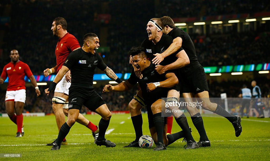 New Zealand players celebrate with try scorer <a gi-track='captionPersonalityLinkClicked' href=/galleries/search?phrase=Julian+Savea&family=editorial&specificpeople=5780264 ng-click='$event.stopPropagation()'>Julian Savea</a> (c) of the New Zealand All Blacks during the 2015 Rugby World Cup Quarter Final match between New Zealand and France at Millennium Stadium on October 17, 2015 in Cardiff, United Kingdom.