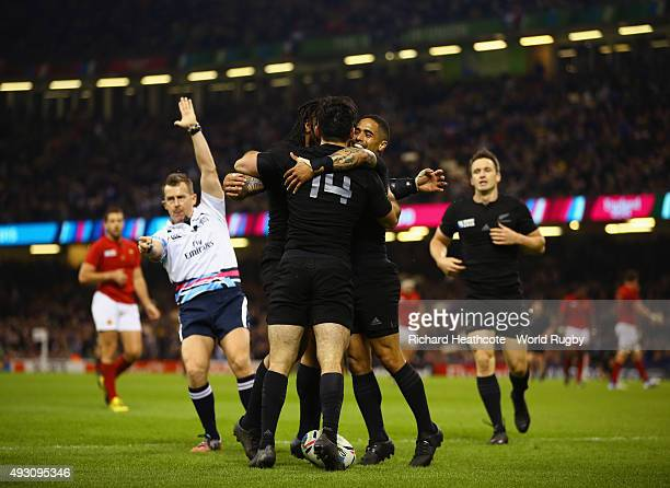 New Zealand players celebrate with try scorer Nehe MilnerSkudder of the New Zealand All Blacks during the 2015 Rugby World Cup Quarter Final match...