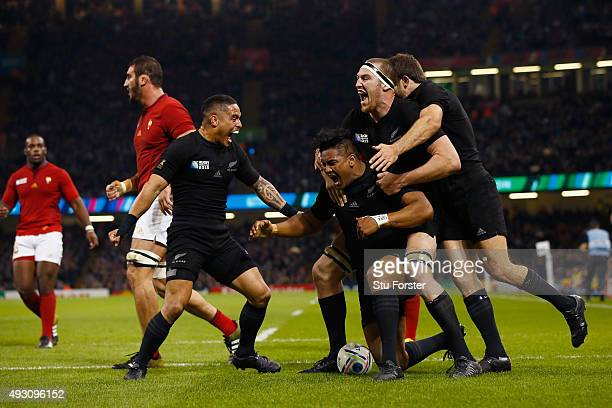 New Zealand players celebrate with try scorerJulian Savea of the New Zealand All Blacks during the 2015 Rugby World Cup Quarter Final match between...