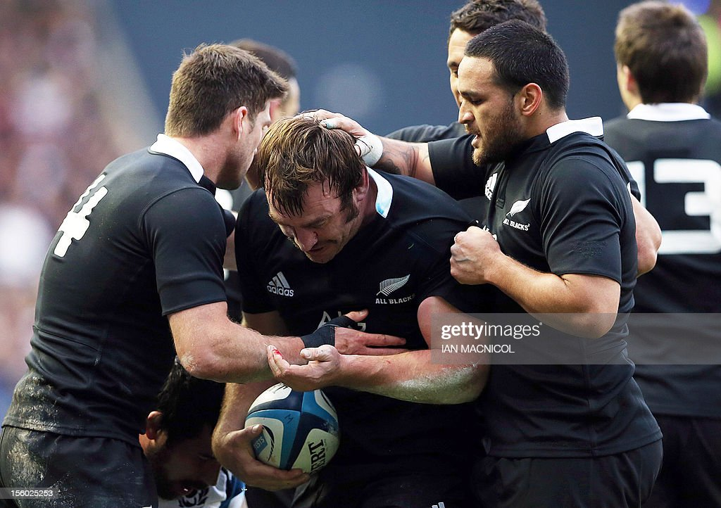 New Zealand players congratulate teammate Andrew Hore (C) after he scored his teams fourth try during the International Rugby Union match between Scotland and New Zealand at Murrayfield in Edinburgh on November 11, 2012. AFP PHOTO / IAN MACNICOL