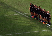 New Zealand players observe a minutes silence for the recent passing of Tonga's King George Tupou V during the Hong Kong Rugby Sevens tournament on...