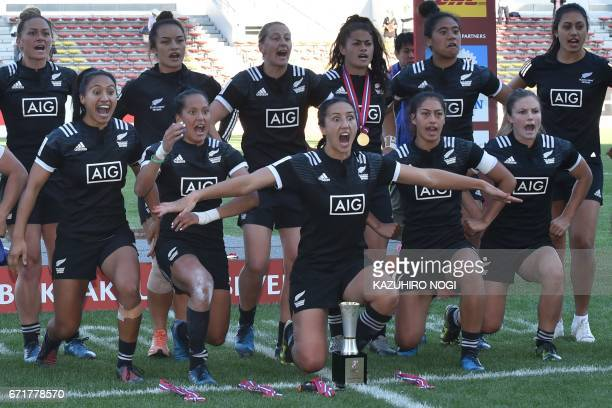 New Zealand players perform the haka as they celebrate their win over Canada during the awards ceremony after the final at the World Rugby Women's...