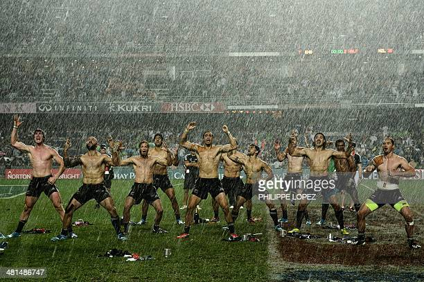 New Zealand players perform the 'haka' in the rain after their victory over England in the final match on the final day of the threeday rugby sevens...