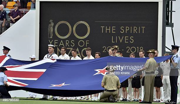 New Zealand players stand behind their flag to commemorate the 100th anniversary of the 1915 ANZAC landing at Gallipoli prior to the day one game of...