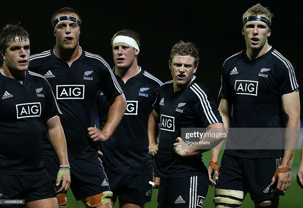 New Zealand players wait for a referee's decision during the 2014 Junior World Championship match between New Zealand and Scotland at ECOLight Stadium, Pukekohe on June 10, 2014 in Auckland, New Zealand.