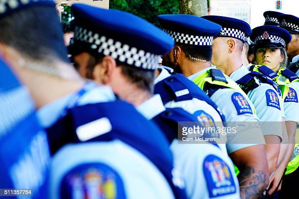 New Zealand police stand guard at the Auckland Pride Party on February 20 2016 in Auckland New Zealand The Auckland Pride Parade is part of the...