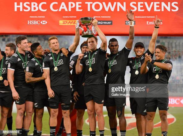 New Zealand pose with the trophy after winning the 2017 HSBC Cape Town Sevens Cup Final match between New Zealand and Argentina at Cape Town Stadium...