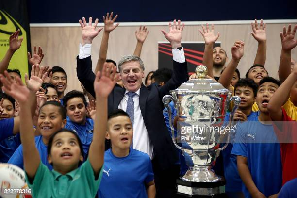 New Zealand Prime Minister Bill English and children from Redoubt Primary School celebrate with the Rugby League World Cup Trophy on July 27 2017 in...