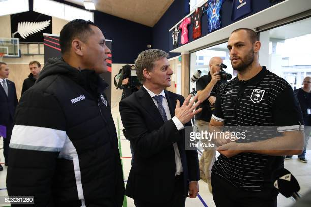 New Zealand Prime Minister Bill English with Kiwis coach David Kidwell and player Simon Mannering at Redoubt Primary School during a Rugby League...