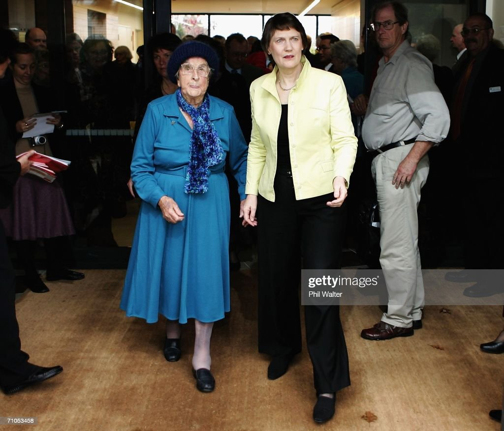 New Zealand Prime Minister Helen Clark (R) takes a tour with elderly resident Katherine White after opening the Bishop Selwyn Apartments, part of the Selwyn Retirement Village May 26, 2006 in Auckland, New Zealand. Clark had earlier announced the decision to send New Zealand soldiers to East Timor for peacekeeping duties.