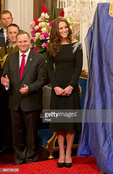 New Zealand Prime Minister John Key and Catherine Duchess of Cambridge look on as they attend an art unveiling of a portrait of Queen Elizabeth II by...