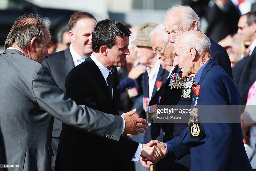 New Zealand Prime Minister John Key and French Prime Minister Manuel Valls greet war veterans following a wreath laying ceremony at the Auckland museum on May 2, 2016 in Auckland, New Zealand. It is the first time in 25 years that a French Prime Minister has visited New Zealand.