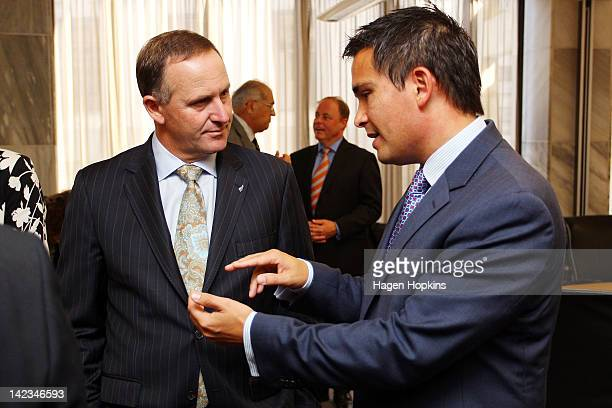 New Zealand Prime Minister John Key and new Minister Simon Bridges talk after his swearing in ceremony at The Beehive on April 3 2012 in Wellington...