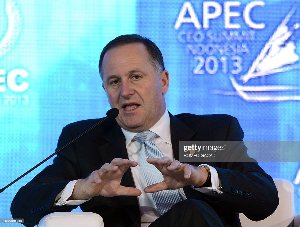 New Zealand Prime Minister John Key delivers an address at the Asia-Pacific Economic Cooperation (APEC) CEO Summit attended by leaders of APEC member countries and top international business executives in Nusa Dua on the Indonesian resort island of Bali on October 6, 2013. Leaders of the 21-member APEC grouping are arriving in Bali ahead of the leader's summit on October 7-8.