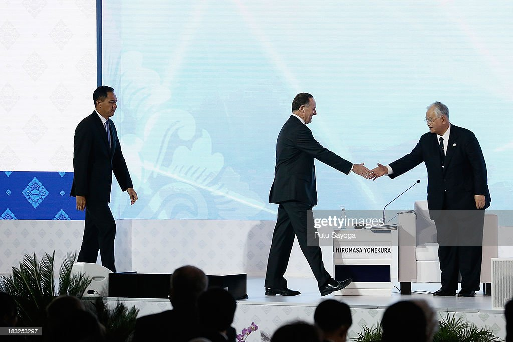 New Zealand Prime Minister John Key (C), Japan Business Federation Keidanren and Sumitomo Chemical Chairman Hiromasa Yonekura (R) and Indonesian Trade Minister Gita Wirjawan attend APEC CEO Summit discussian panel with business leaders on October 6, 2013 in Nusa Dua, Indonesia.