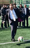 New Zealand Prime Minister John Key kicks a ball during a football clinic by New Zealand national football team for South Korean students in Seoul on...