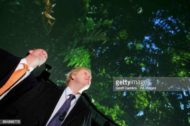 New Zealand Prime Minister John Key left and Mayor of London Boris Johnson watch a groundbreaking audiovisual display inside the world's largest...