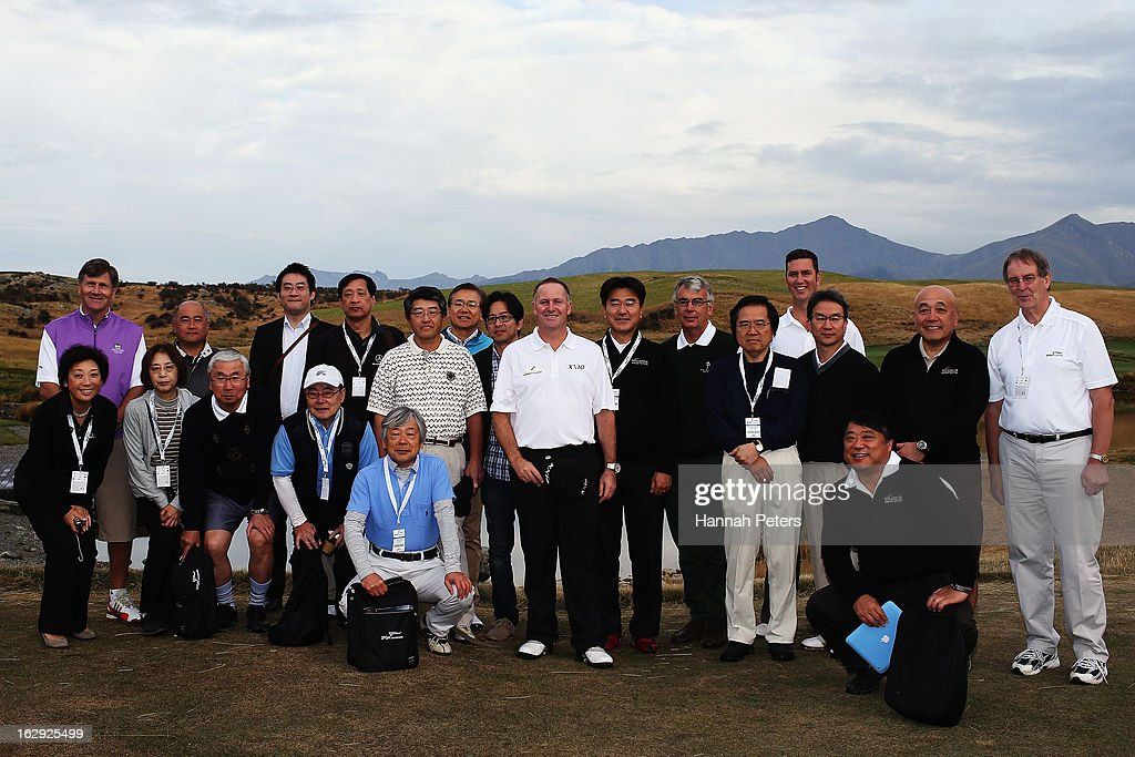 New Zealand Prime Minister John Key poses for a photo with a group of international businessmen who have come to New Zealand from Japan, Korea, Australia following a powhiri prior to the start of the PGA Challenge, the ancillary event to the NZ PGA Championship at Jack's Point Golf Club on March 2, 2013 in Queenstown, New Zealand.