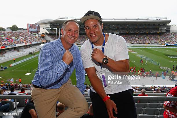 New Zealand Prime Minister John Key poses with boxer Joseph Parker during the 2016 NRL Auckland Nines at Eden Park on February 6 2016 in Auckland New...