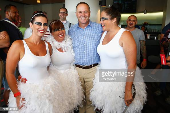 New Zealand Prime Minister John Key poses with fans during the 2016 NRL Auckland Nines at Eden Park on February 6 2016 in Auckland New Zealand