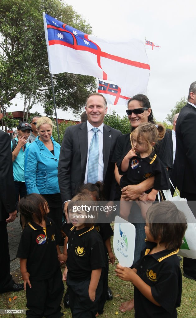 New Zealand Prime Minister John Key stops to pose with young children from Te Ohaki Te Kohanga Reo after visiting Te Tii Marae on February 5, 2013 in Waitangi, New Zealand. The Waitangi Day national holiday celebrates the signing of the treaty of Waitangi on February 6, 1840 by Maori chiefs and the British Crown, that granted the Maori people the rights of British Citizens and ownership of their lands and other properties.