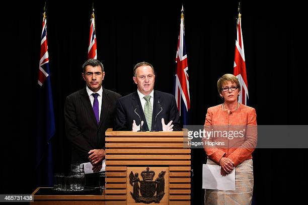 New Zealand Prime Minister John Key talks to the media while Minister for Primary Industries Nathan Guy and Food Safety Minister Jo Goodhew look on...