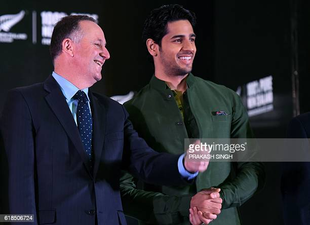 New Zealand Prime Minister John Key talks with Indian actor and Tourism New Zealand Brand Ambassador Sidharth Malhotra during an event in New Delhi...