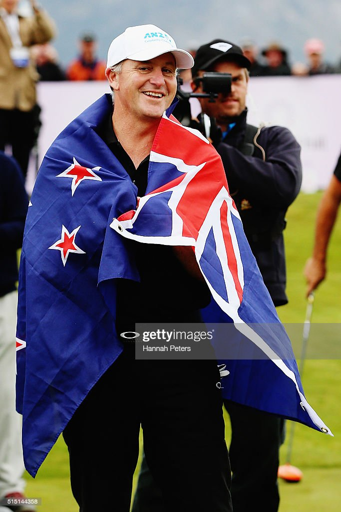 New Zealand Prime Minister <a gi-track='captionPersonalityLinkClicked' href=/galleries/search?phrase=John+Key&family=editorial&specificpeople=2246670 ng-click='$event.stopPropagation()'>John Key</a> wears the New Zealand flag given to him by former Australian cricketer Ricky Ponting during day four of the 2016 New Zealand Open at The Hills on March 13, 2016 in Queenstown, New Zealand.