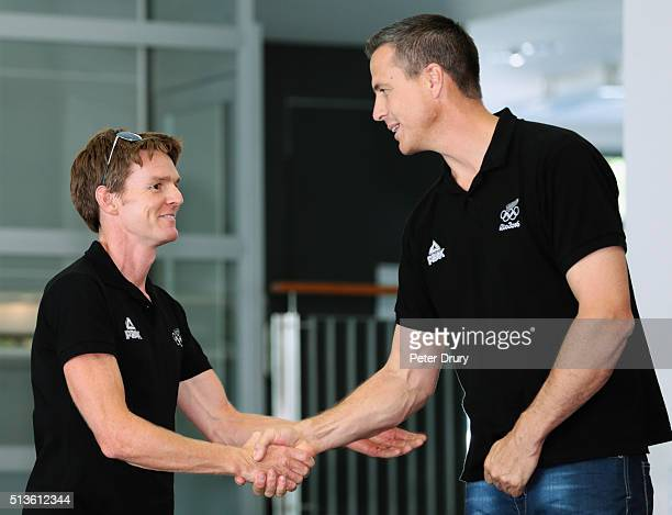 New Zealand rower Peter Taylor is congratulated by NZOC Chef de Mission Rob Waddell during the New Zealand Olympic Rowing Team Announcement at Lake...