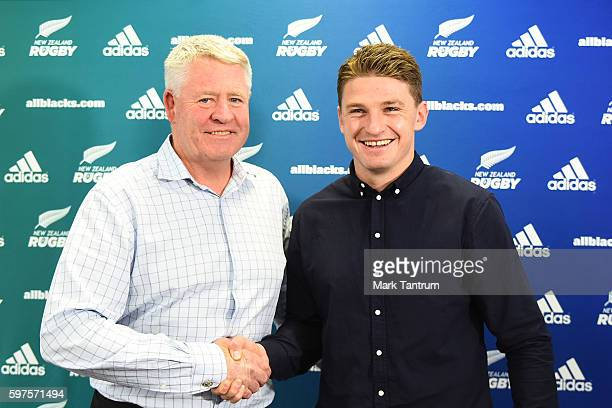 New Zealand Rugby Chief Executive Steve Tew and Beauden Barrett shake hands after Barrett resignied with the All Blacks and Hurricanes teams at New...
