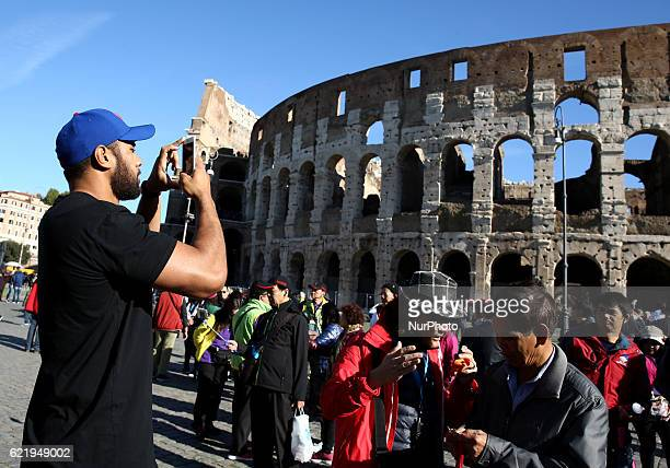 New Zealand rugby team All Blacks visiting the Colosseum Patrick Tuipulotu taking a photo in Rome Italy on November 9 2016