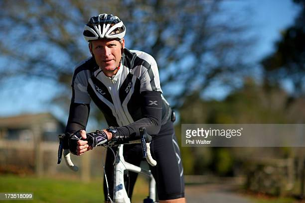 New Zealand single skull rower Mahe Drysdale poses on his road bike during a portrait session on July 16 2013 in Cambridge New Zealand