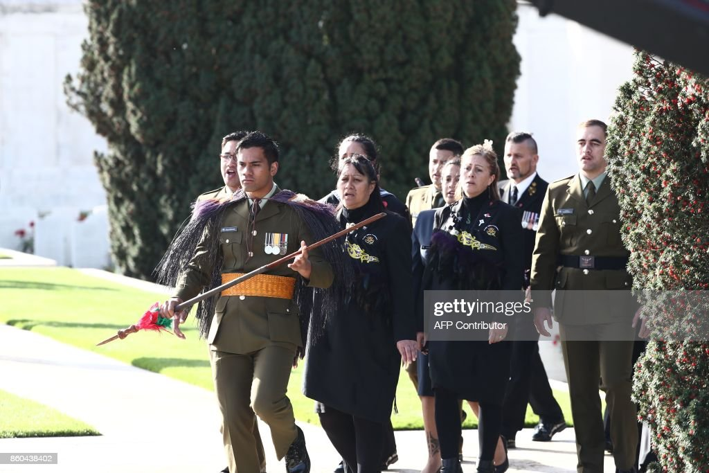 New Zealand soldiers attend a commemoration at the Tyne Cot Commonwealth War Graves Cemetery for the centenary of Passchendaele, the third battle of Ypres on 30th and 31st July 2017, on October 12, 2017 in Passendale, Zonnebeke. New Zealand is commemorating on October 12 the centenary of the World War I Battle of Passchendaele. / AFP PHOTO / BELGA / KURT DESPLENTER / Belgium OUT