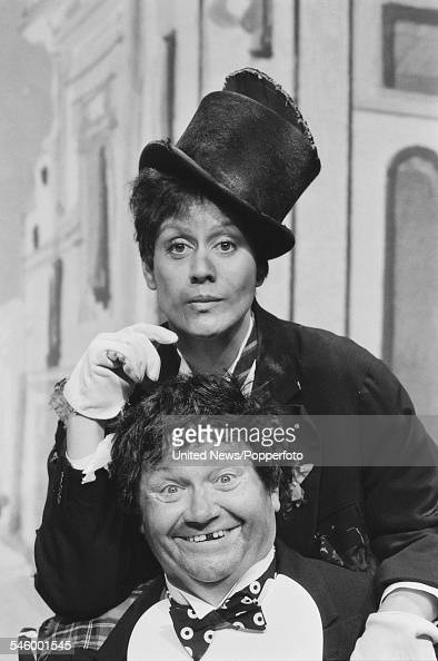 New Zealand soprano singer Kiri Te Kanawa pictured together in costume with Welsh singer and entertainer Harry Secombe during filming of the BBC...