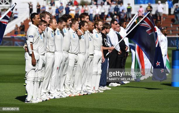 New Zealand stand for the national anthems during the 2nd International cricket test match between New Zealand and South Africa at the Basin Reserve...