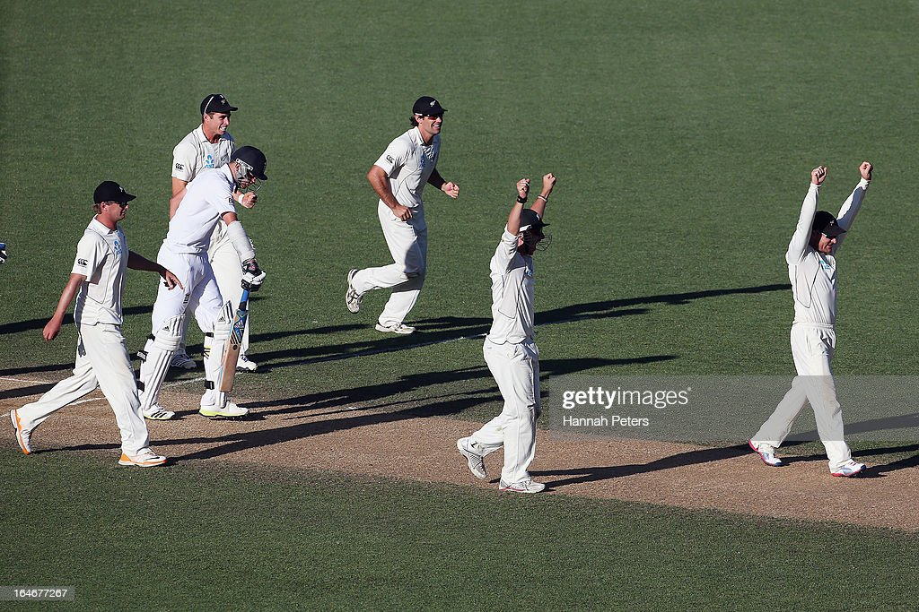 New Zealand sucessfully appeal for the wicket of Stuart Broard of England during day five of the Third Test match between New Zealand and England at Eden Park on March 26, 2013 in Auckland, New Zealand.