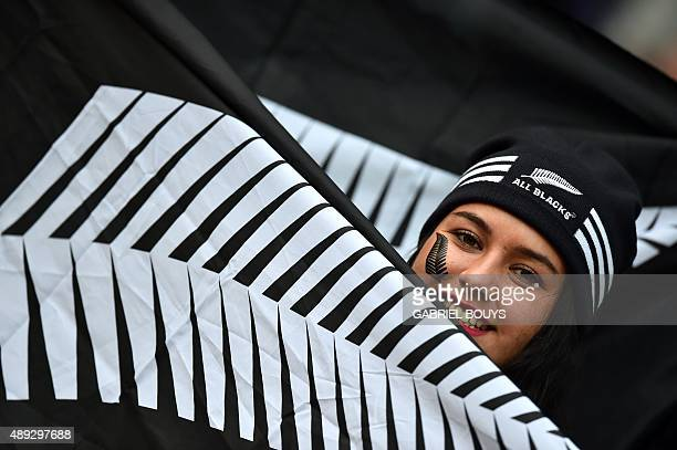 A New Zealand supporter poses with an All Blacks' flag before a Pool C match of the 2015 Rugby World Cup between New Zealand and Argentina at Wembley...