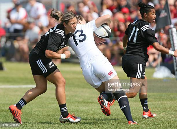 New Zealand tackles Emily Scarratt of the England squad during the Women's Rugby Super Series at Red Deer Rugby Club on July 1 2015 in Red Deer...